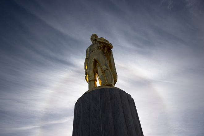 The Oregon Pioneer stands atop the Oregon State Capitol, in Salem, Ore. on Tuesday, Feb. 9, 2021.