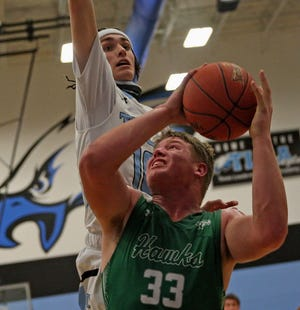 Wall's Tate Williams, center, puts up a shot under the basket during a game against TLCA on Tuesday, Feb. 9, 2021.
