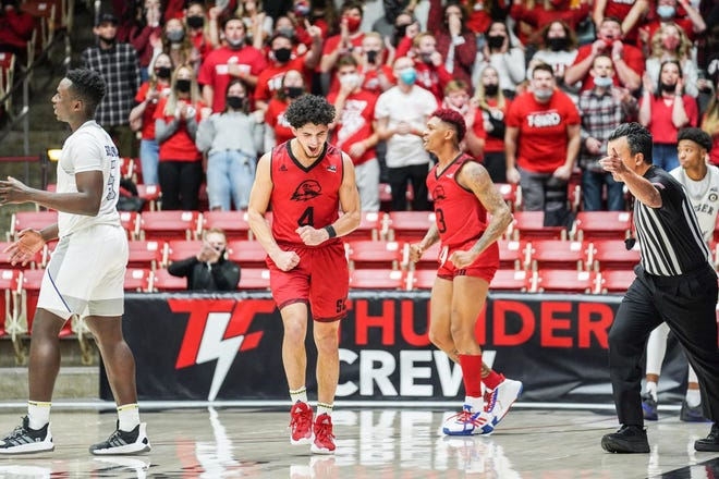 SUU's Dre Marin (4) celebrates late during a game against Weber State earlier this season.