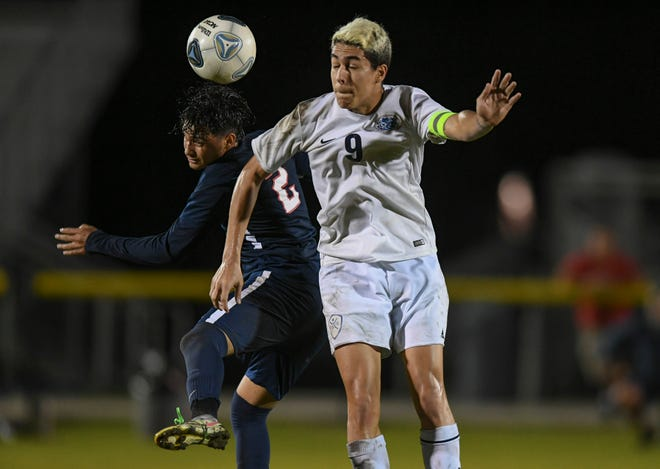 St. Lucie West Centennial's Florencio Damien (2) and Dwyer's Ivan Celis fight for control during the first half of their Class 7A District 9 boys soccer championship on Tuesday, Feb. 9, 2021 at the South County Stadium in Port St. Lucie. Centennial won against Dwyer, 3-1.