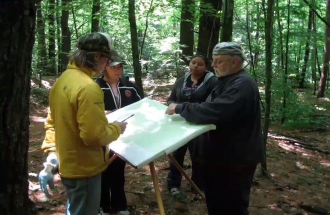 David Overstreet, a professor at the College of Menominee Nation, maps the ancient gardens with friends.