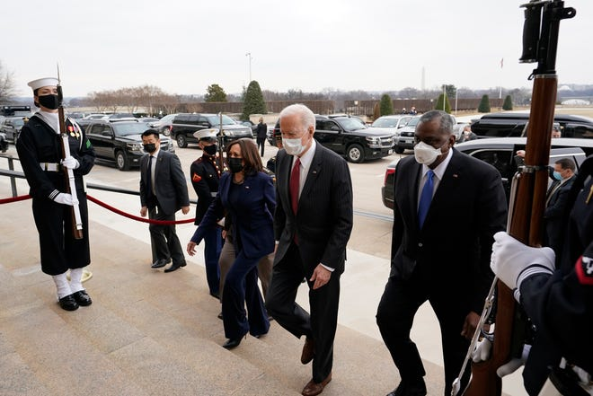 From left, Vice President Kamala Harris, President Joe Biden and Secretary of Defense Lloyd Austin walk up the steps at the Pentagon, Feb. 10, 2021.