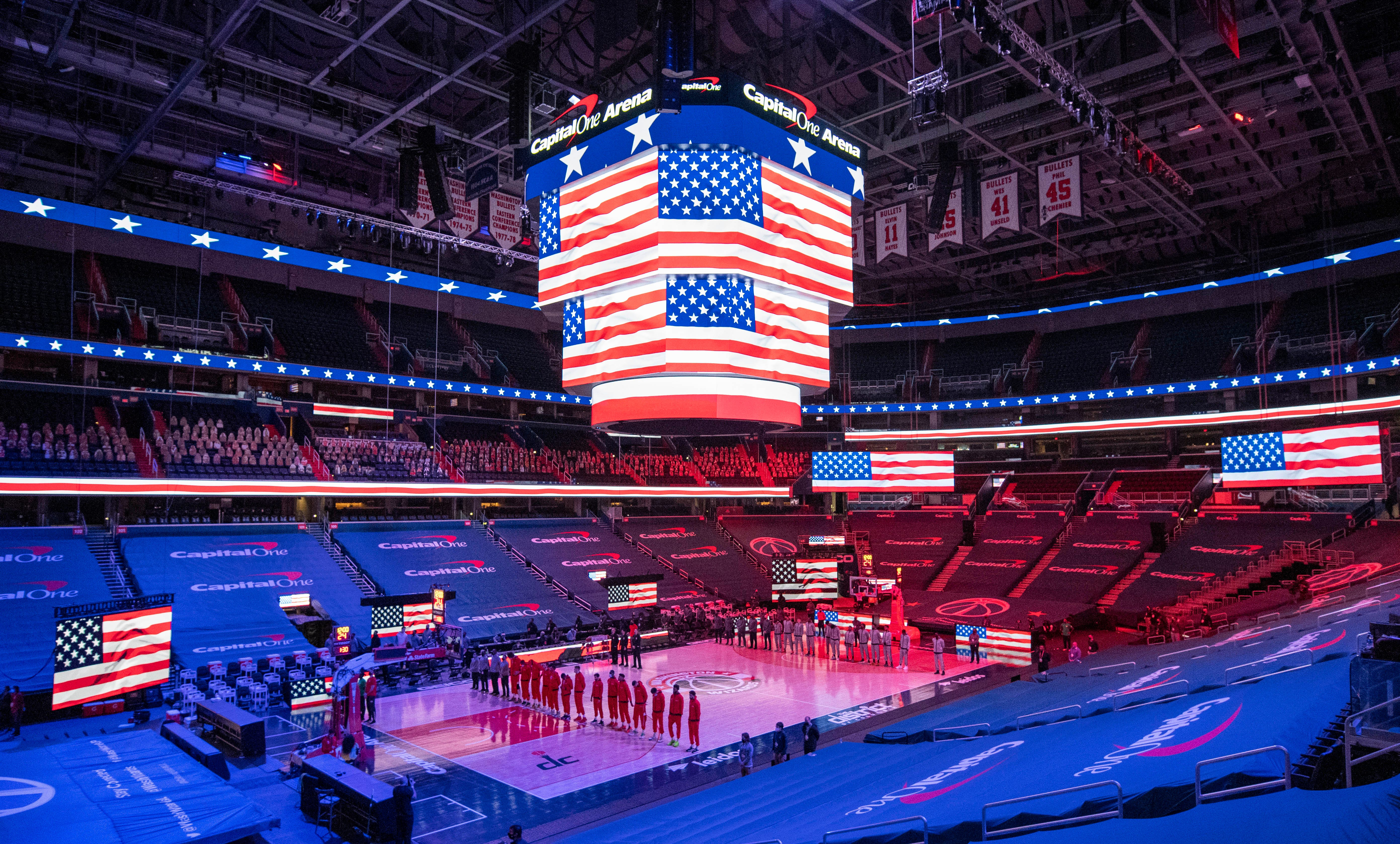 The Washington Wizards and Atlanta Hawks listen to the national anthem being played at Capital One Arena in January.