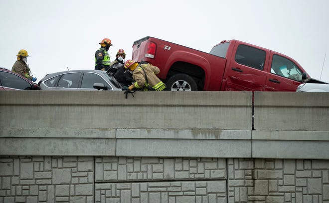 Emergency responders work at a 26-car pileup on Texas 45 near Briarwick Drive on Thursday.