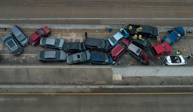 Emergency crews respond to a 26-vehicle pileup on Texas 45 near Briarwick Drive in Northwest Austin on Thursday.