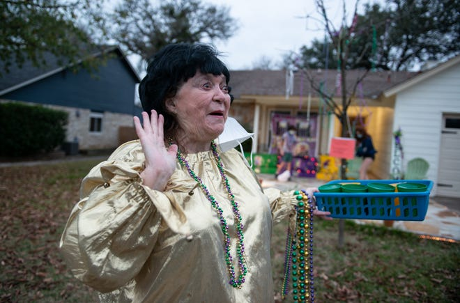 New Orleans native Linda Clarke hands out beads, cups and king cake babies to her neighbors as part of her participation in the Krewe of House Floats, a socially distant way to celebrate Mardi Gras.