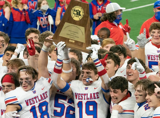 Westlake football players hoist the Class 6A Division I championship trophy after their 52-34 win over Southlake Carroll at AT&T Stadium in Arlington on Jan. 16. The title was the third for Westlake and the first in the division for the state's largest schools.