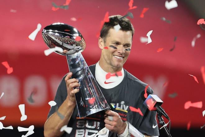 Feb 7, 2021; Tampa, FL, USA; Tampa Bay Buccaneers quarterback Tom Brady (12) hoists the Vince Lombardi Trophy after defeating the Kansas City Chiefs in Super Bowl LV at Raymond James Stadium.  Mandatory Credit: Matthew Emmons-USA TODAY Sports