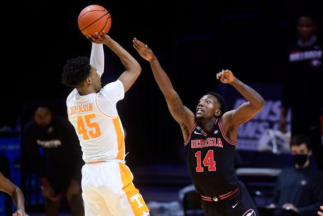 Tennessee guard Keon Johnson (45) is guarded by Georgia's Tye Fagan (14) during a basketball game between the Tennessee Volunteers and the Georgia Bulldogs at Thompson-Boling Arena in Knoxville, Tenn., on Wednesday, Feb. 10, 2021.