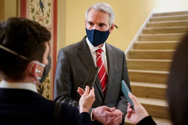 Sen. Rob Portman, R-Ohio, speaks with reporters during a break in the second impeachment trial of former President Donald Trump, at the Capitol, Wednesday, Feb. 10, 2021, in Washington. (Joshua Roberts/Pool via AP)