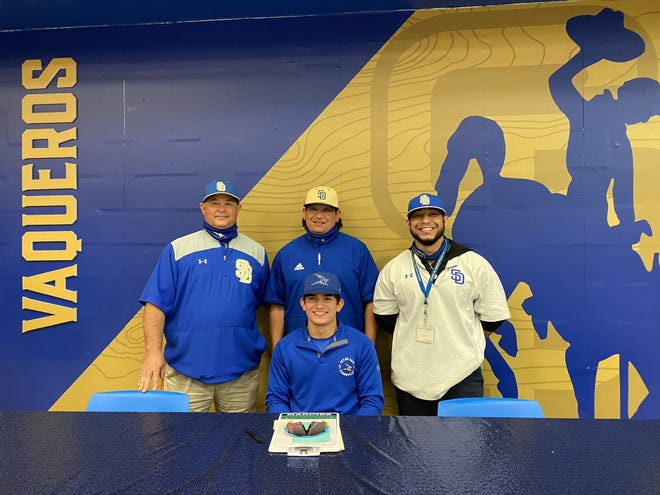 San Diego senior Brandon Ramirez, middle, signed a letter of intent to play baseball at Texas A&M-Kingsville next season. Standing from the left is San Diego coaches Victor Garcia, Juan Mendietta and Ryan Guerrero.