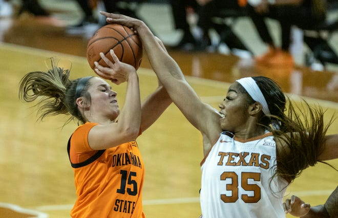 Texas junior Charli Collier blocks a shot by Oklahoma State's Lexy Keys during Wednesday's 64-53 Longhorns win at the Erwin Center. Texas avenged last month's 68-51 loss in Stillwater.