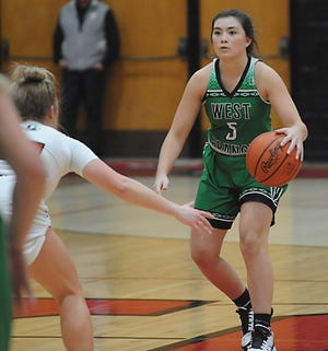 West Branch's Bella Laut brings the ball up the court in an Eastern Buckeye Conference game against the Lady Quakers at Salem High School Wednesday, February 10, 2021.