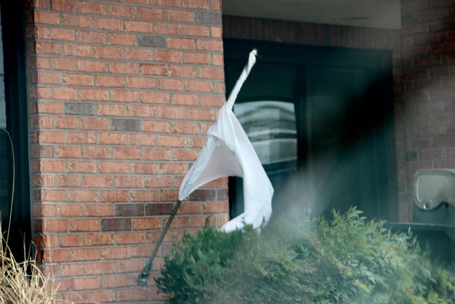 A white flag waves in the wind outside the Salvation Army's homeless shelter. The white flag signals that the organization will be letting in individuals beyond its typical requirements