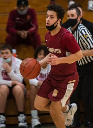 New Brighton's Xavier 'JoJo' Reynolds heads to the basket during the Lions' game Wednesday at Riverside High School in North Sewickley Township.