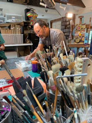 Artist Carl Lopes, seen here in his Marstons Mills studio, has been chosen as this year's Citizens Bank Pops by the Sea commemorative artist.