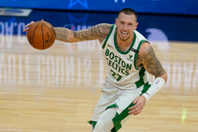 Boston Celtics center Daniel Theis dribbles against the Golden State Warriors during a Feb. 2 game in San Francisco.