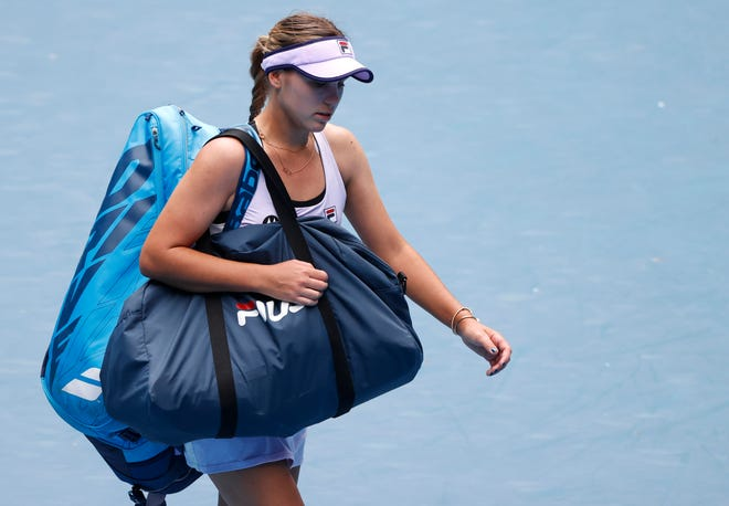 United States' Sofia Kenin leaves the court following her second round loss to Estonia's Kaia Kanepi during at the Australian Open tennis championship Thursday in Melbourne, Australia.