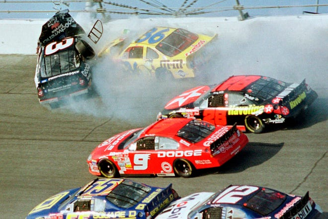 Dale Earnhardt's (3) window pops out of the car after being hit by Ken Schrader (36) during the Daytona 500 auto race on Feb. 18, 2001 at Daytona International Speedway in Daytona Beach, Fla. Losing Earnhardt forced the stock car series to confront safety issues it had been slow to even acknowledge, let alone address.