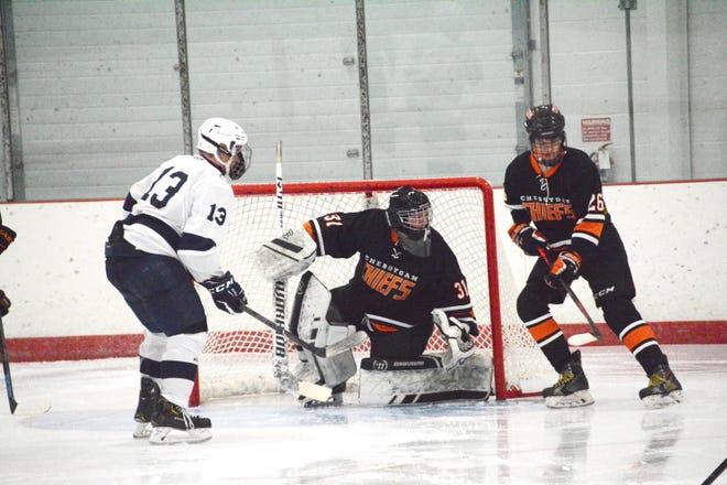 Cheboygan goalie Scott Pavwoski (31) and defenseman Jordan Elenbaas (26) keep a close watch on Sault High's Nick Cicco (13) during a season-opening hockey game at Big Bear Arena Wednesday night.