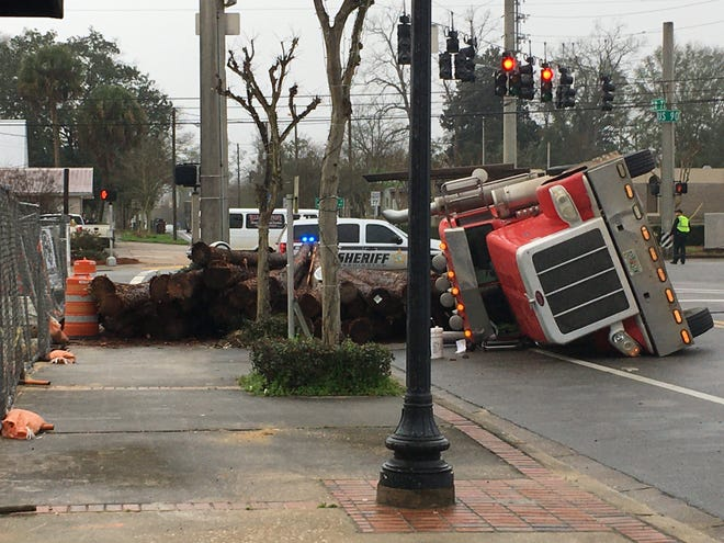 A semitruck transporting thousands of pounds of logs overturned Wednesday morning at the intersection of State Road 77 and U.S. 90 in Chipley.