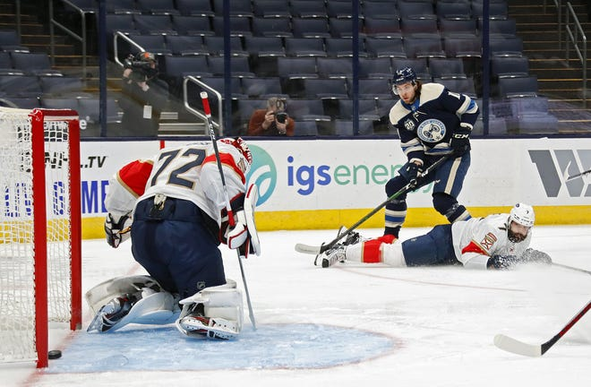 Kevin Stenlund (11) of the Blue Jackets scores from an angle against Panthers goalie Sergei Bobrovsky in a Jan. 26 game in Nationwide Arena.