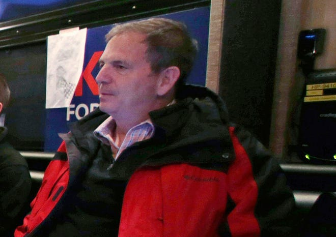 In this Jan. 20, 2016, file photo, John Weaver is shown on a Kasich for President campaign bus in Bow, N.H.