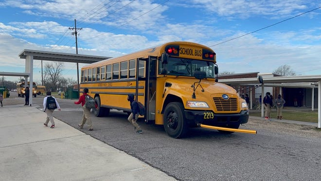 Students step off a newly leased, 2022-model Lafourche Parish school bus.