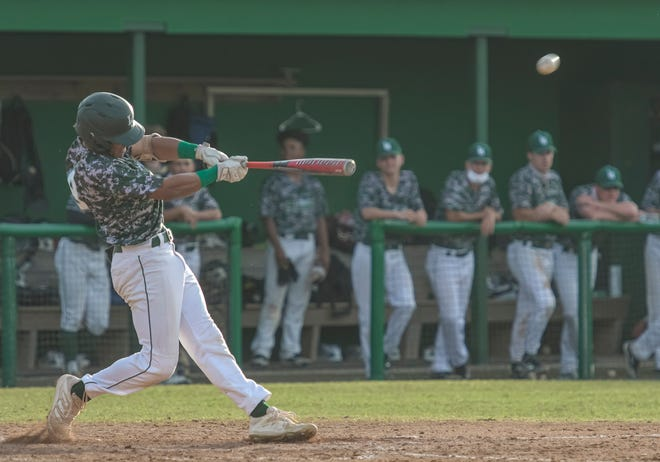 Lake-Sumter State College shortstop Nick Coello (9) hits a home run in the seventh inning of Wednesday's game against South Florida State College at the LSSC baseball complex in Leesburg. [PAUL RYAN / CORRESPONDENT]