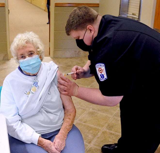 Nancy Kemp receives her first COVID-19 shot from Cody Post of the Chippewa Township Fire Department during a Wayne County Health Department vaccine clinic last week. The clinic was held at the Wooster Nazarene Church.