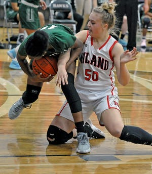 Laurel's Helen Holley and Hiland's Zoe Miller get tangled while fighting for possession.