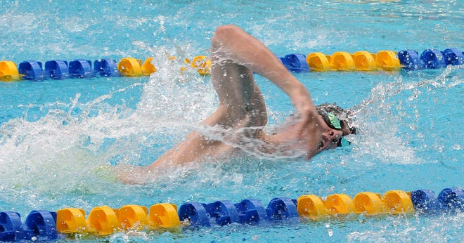 Massillon senior Magnus Haines competes in the boys 50 freestyle in the Division I sectional meet at Wooster High School, Thursday, Feb. 11, 2021.