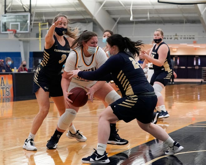Siena Heights' Peyton Banks battles with the ball during a game against Cornerstone in the 2020-21 season.