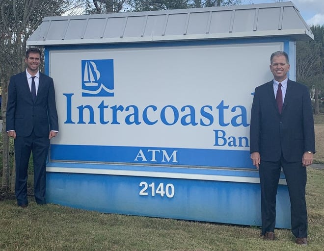 Ryan Page, left, the newly named president of Intracoastal Bank, stands in front of a sign for the community bank's Daytona Beach location at 2140 LPGA Blvd., with his father, Bruce, Intracoastal's founding CEO who recently also became board chairman.