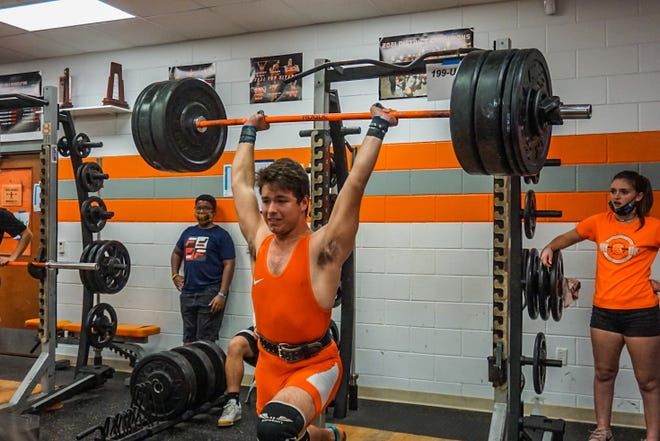 University High's James Padgett, competing in the 199-pound weight class, completes a clean-and-jerk lift of 270 pounds Wednesday, Feb. 10, 2021.