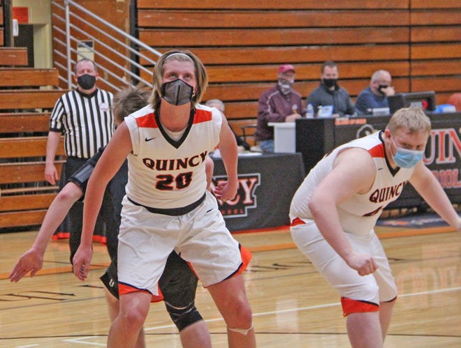 Quincy's Kyle Rodesiler (20) and AJ Henderson (right), shown here in their season opener on Tuesday, helped lead the Orioles to a big road win over Mendon Wednesday night.