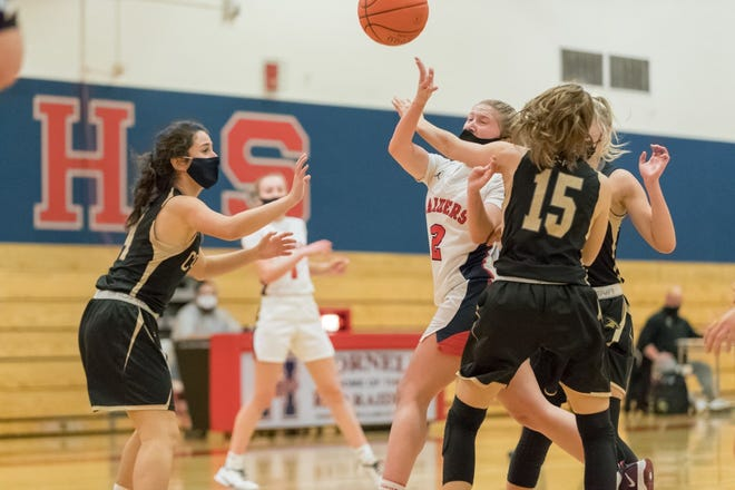 Hornell's Jaden Sciotti (2) fights through contact on her way to the rim during Wednesday's opener.