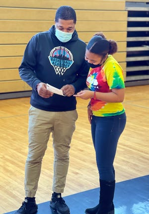 First-year Van Horn girls basketball coach Eric Daniels goes over some pregame notes with team manager Aleisa Washington. Daniels returns for a game Friday to Summit Christian Academy, where he first coached alongside former Eagles boys coach Jake Kates. Daniels is eager to return to his former school.