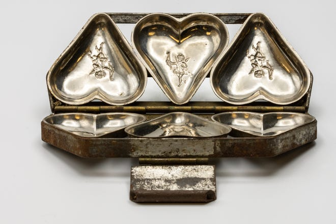 A heart-shaped chocolate mold, an Out of the Attic item, is shown at the Des Moines County Heritage Center, 504 N. Fourth St., in Burlington. The artifact originally was used by Gardener's and Gould Candy Co. to mold Valentine's Day chocolates, which were distributed by Fern Brand Candies (owned by Gardiner and Gould).