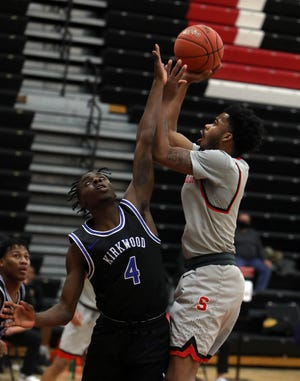 Southeastern Community College's Kennedy Milton (2) puts up a shot over Chris Burnell (4) during their home game against Kirkwood Community College, Wednesday Feb. 10, 2021 at SCC's Loren Walker Arena.