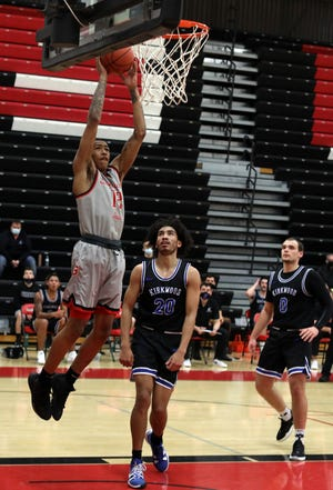 Southeastern Community College's Jesiah West (12) dunks the ball during their home game against Kirkwood Community College, Wednesday Feb. 10, 2021 at SCC's Loren Walker Arena.