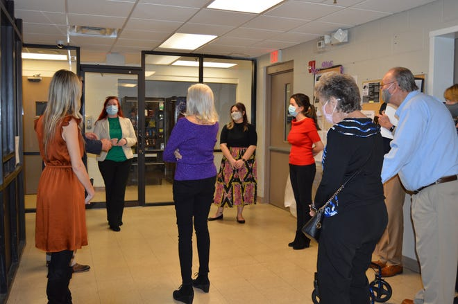 Donors and staff learn about The Salvation Army of Northeast Florida's new Bundle of Hope Room as social services director Tami Gonyea (left rear, facing group) talks about the designated shelter space for expectant women.