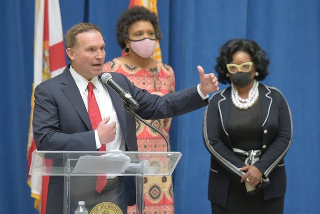 Jacksonville Mayor Lenny Curry, with City Council members Brenda Priestly Jackson, center, and Ju'Coby Pittman announces a funding plan on Thursday for completing septic tank phaseouts at three northwest Jacksonville neighborhoods. City Council member Sam Newby also joined Curry for the announcement.