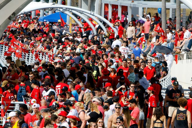 Thousands of fans lined up on the banks of the Hillsborough River to celebrate the boat parade of the Super Bowl LV champion Tampa Bay Buccaneers on Wednesday, Feb. 10, 2021 in Tampa, Fla.