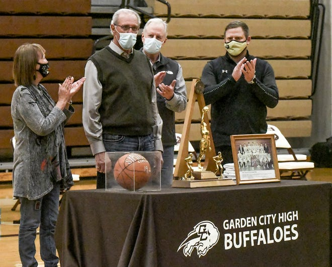 Archie Gooden, second from left, was honored Tuesday between the Garden City High School girls and boys basketball games as being one of this year's inductees into the GCHS Athletics Hall of Fame.  Gooden, a 1966 GCHS graduate, was selected for boys basketball.