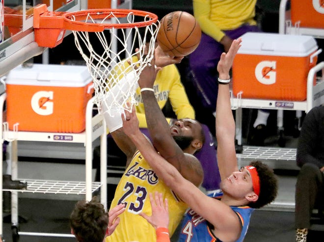 The Los Angeles Lakers' LeBron James (23) goes to the basket against the Oklahoma City Thunder's Justin Jackson in the second quarter at Staples Center in Los Angeles on Wednesday, Feb. 10, 2021. The Lakers won 114-113 in overtime.