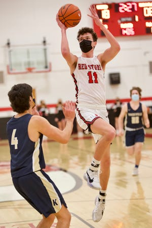 United High School senior Declan Flynn rises for a jumper over Knoxville senior Evan Rossell during the Red Storm's 71-46 win over the visiting Blue Bullets on Wednesday, Feb. 10, in rural Monmouth.