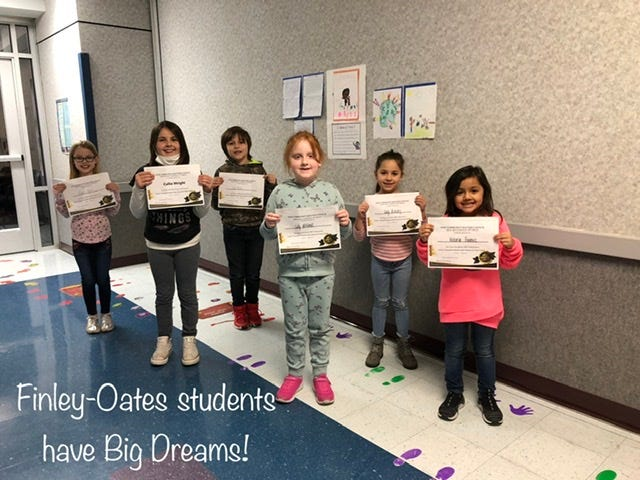 Winners of the OCM art contest are presented with award certificates.