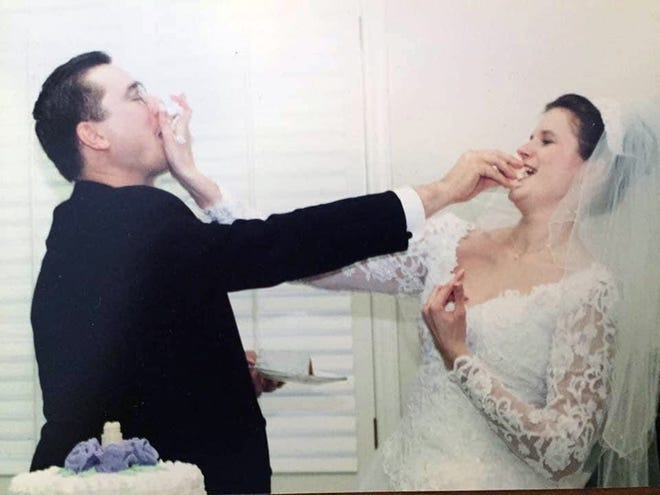 Heidi and Phillip Scheibmeir share a little fun and cake at their wedding in this photo from nearly 20 years ago.