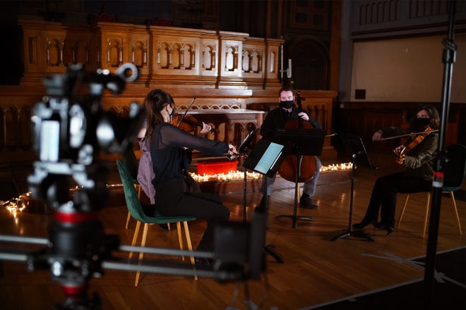 Take a peek behind the scenes with the Newport String Project.